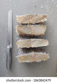 Freshly cut salted codfish slices.