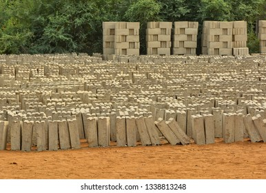 Freshly formed bricks are on a yard. Brick manufacturing in developing countries.