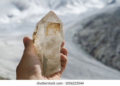 Freshly found clear quartz crystal on the glacier in the French Alps