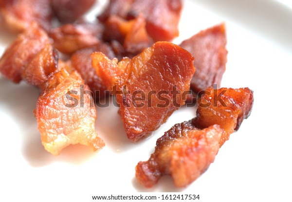 freshly fried bacon pieces on the plate