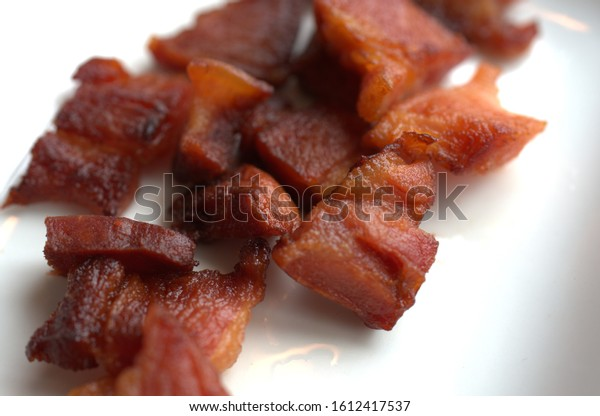 freshly fried brown bacon pieces