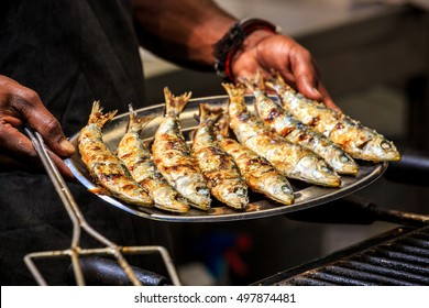 Freshly grilled sardines on a silver plate