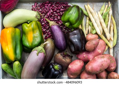 Freshly Harvested Homegrown Vegetables such as Beetroots, Aubergines, Lettuce, Red Potatoes, Black and Green Peppers, Beans, on the Rustic Wooden Background, Top View, shallow DOF, selective focus