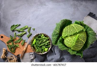 Freshly harvested savoy cabbage ready to prepare traditional food. Vertical flat lay.