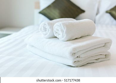 Freshly laundered fluffy towels on bed in hotel