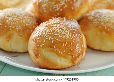 Freshly made buns with sesame seeds.