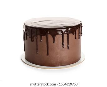 Freshly made delicious chocolate cake on white background