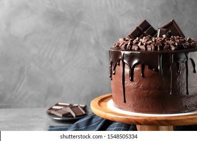 Freshly made delicious chocolate cake on grey background