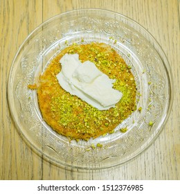 Freshly made Kanafeh with pistachios and Ice cream on top and covered with syrup. this middle eastern dessert will blow your mind!