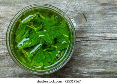 Freshly made mint tea on the wooden table
