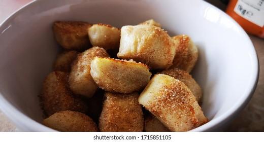 freshly made Pretzel Bites coated in Cinnamon Sugar in a white bowl