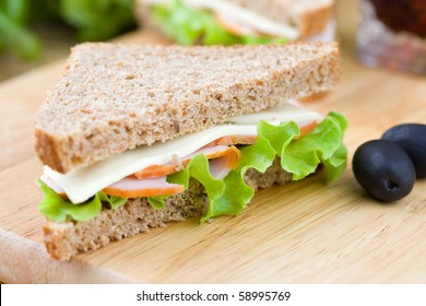 Freshly made sandwich with dietetic bread, ham and lettuce