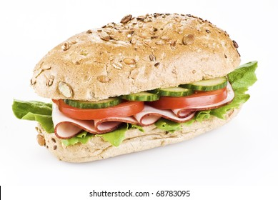 Freshly made sandwich with ham and vegetables over white