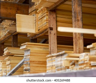 Freshly milled wood stacked on shelves in a lumber yard ready for sale.