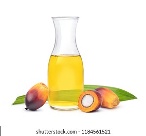 Freshly Oil Palm seed and cut in half with cooking palm oil in glass jar isolated on white background