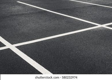 Freshly painted parking lot car park bays shot at an angle.