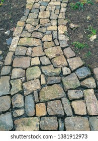 freshly paved natural stone path