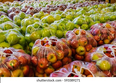 Freshly picked and bagged apples ready for distribution.