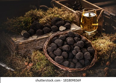 Freshly picked black truffles on market table with very fancy decoration