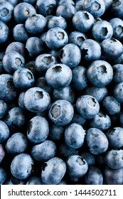 Freshly picked blueberries in a bowl close up. Juicy and fresh blueberries on rustic table. Bilberry on dark background. Blueberry antioxidant. Concept for healthy eating and nutrition