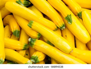 Freshly picked colorful yellow squash on display at the farmers market