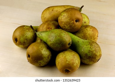 Freshly picked organic pears on a wooden table top