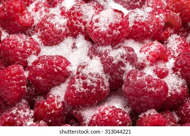 freshly picked ripe red raspberries and suger. Raspberry fruit background
