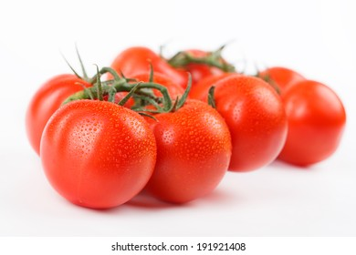 freshly picked ripe tomatoes on a branch