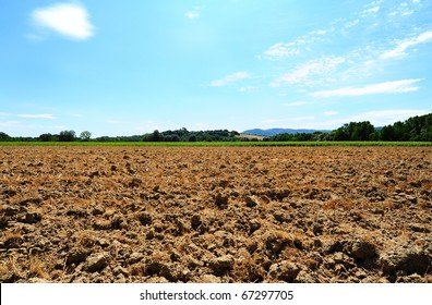 Freshly Plowed Field In Spring Ready For Cultivation