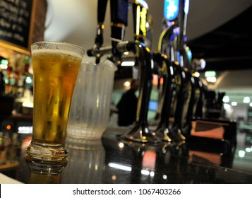 A freshly poured glass of beer sits at a Scottish Pub