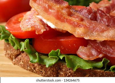 Freshly prepared bacon, lettuce, and tomato sandwich on whole grain wheat toast.  Macro with extremely shallow dof.