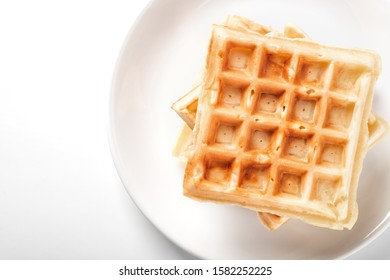 Freshly prepared belgian waffles on the plate