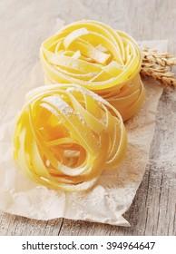 Freshly prepared fettuccine pasta closeup. Pasta tagliatelle with wheat.