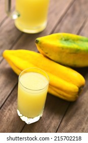 Freshly prepared juice out of the Ecuadorian Babaco fruit (lat. Vasconcellea x heilbornii; syn. Carica pentagona) (Selective Focus, Focus on the front rim of the glass)