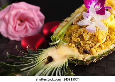 Freshly prepared pineapple fried rice served inside of a pineapple carved like a bowl