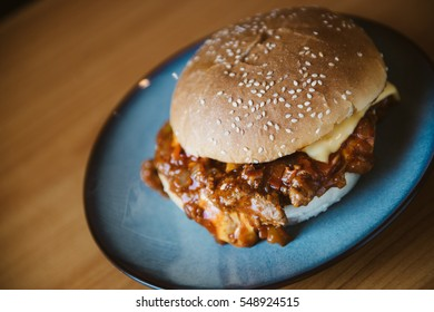 Freshly prepared sloppy joe sandwich with cheese .Macro with shallow dof.