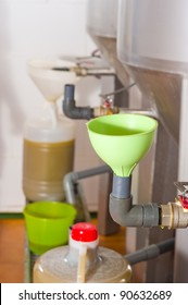 Freshly pressed olive oil being filled