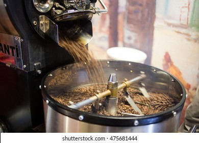 Freshly roasted coffee beans being poured into the cooling down rotator, with motion blur