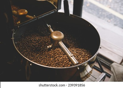 freshly roasted coffee beans n a coffee roaster