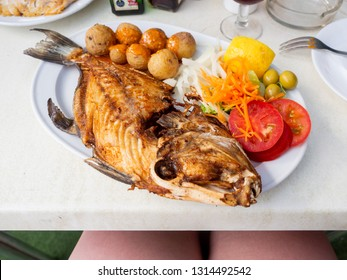 Freshly roasted flounder fish with vegetables and Mojo sauce