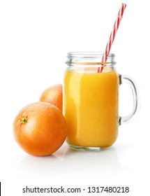 Freshly squeezed orange juice in glass mason jar with straw. Fresh orange fruits. Natural organic drink for healthy eating and healthy lifestyle. Isolated on white bckground. Clipping path included.