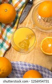 freshly squeezed sweet orange juice with ice cubes in a glass