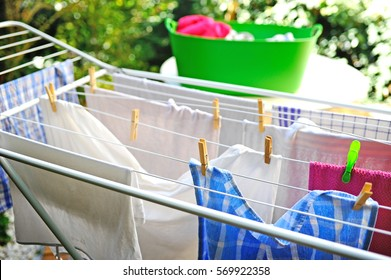 Freshly washed clothes drying outdoor on drying rack