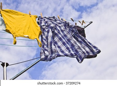 Freshly washed clothes hang out to dry on a sunny day