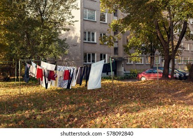 Freshly washed loundry is hanging in the clothesline in some lithuanian town