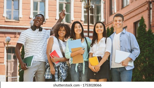 Freshmen Orientation Concept. Group Of First Year Students With Workbooks Posing Together Outdoors, Panorama With Free Space