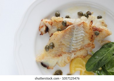 Freshness cod fillet sauteed served with lemon and capers butter sauce
