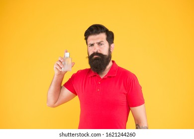 Freshness concept. Wearing perfume. Choose perfume for men according to occasion. Make sure smell fresh throughout day. Benefits using perfumes. Man well groomed bearded handsome hold bottle perfume.