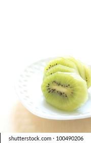 Freshness cut fruit, Kiwi fruit on elegant dish with copy space on white background
