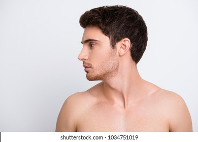 Freshness daily everyday lifestyle people person concept. Half-faced view portrait of attractive handsome serious concentrated guy with stylish modern hairdo isolated on gray background copy-space